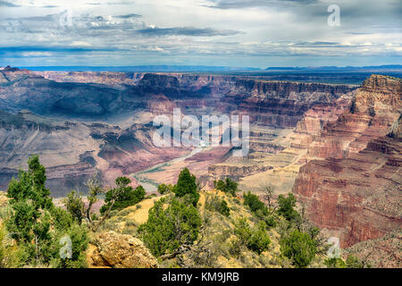 Grand Canyon National Park Arizona landscape view with the Colorado River in the distance. Layered bands of red - Stock Image