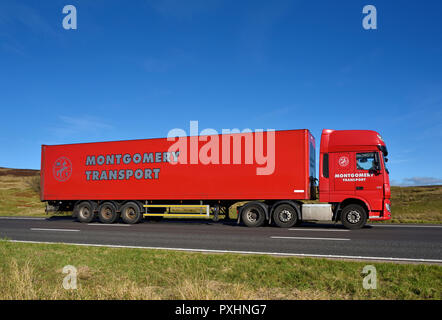 Montgomery Transport HGV. M6 motorway Southbound carriageway, Shap, Cumbria, England, United Kingdom, Europe. - Stock Image