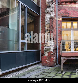 Wall of old building and facde of new building s in Inner courtyard in Mitte,berlin - Stock Image