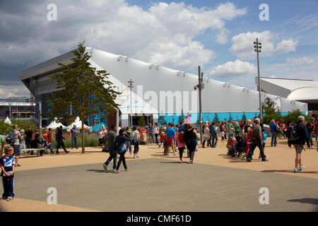Water Polo Arena and people on a sunny day at Olympic Park, London 2012 Olympic Games site, Stratford London E20 - Stock Image