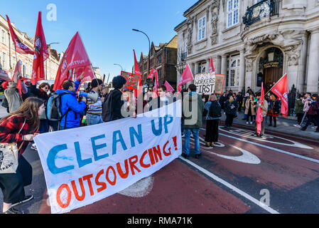 London, UK. 14th February 2019. The IWGB union and students block New Cross Road outside the management offices in Deptford Town Hall at the launch of their campaign for Goldmsiths, University of London, to directly employ its security officers. Currently they are employed by CIS Security Ltd on low pay and minimal conditions of service, and CIS routinely flouts its legal responsibilities on statutory sick pay and holidays. Credit: Peter Marshall/Alamy Live News - Stock Image