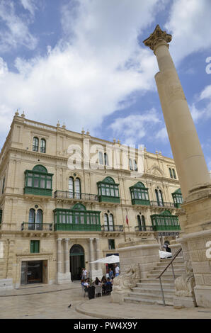 Buildings in the Maltese capital of Valletta showing the traditional painted wooden balconies known as Gallariji - Stock Image