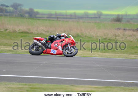 East Fortune, UK. 14 April, 2019. 75 Harry Pullar riding a Yamaha R6 in a Pre-injection 600, Pre-injection 1200 and Sound of Thunder Championship race at East Fortune Raceway, during the opening rounds of the 2019 Scottish Championships, Melville Open and Club Championships. Credit: Roger Gaisford/Alamy Live News - Stock Image