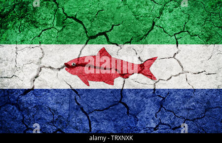 Federal Dependencies of Venezuela flag on dry earth ground texture background - Stock Image