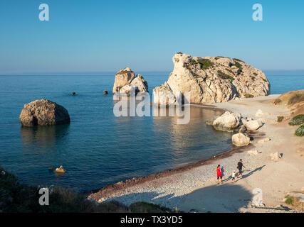 Early morning sunshine illuminates Aphrodite's Rock (Petra Tou Romiou) near Kouklia, Paphos region, Republic of Cyprus. - Stock Image