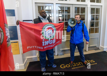 London, UK. 14th February 2019. General Secretary of the IWGB, Jason Moyer-Lee leads IWGB union and students nto the main Goldsmiths building at the launch their campaign for Goldmsiths, University of London, to directly employ its security officers. Currently they are employed by CIS Security Ltd on low pay and minimal conditions of service, and CIS routinely flouts its legal responsibilities on statutory sick pay and holidays. Credit: Peter Marshall/Alamy Live News - Stock Image