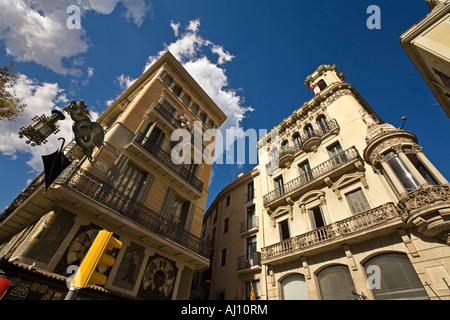 Spain Barcelona Las Ramblas Art Deco architecture Dragon with laterne umbrella shop - Stock Image