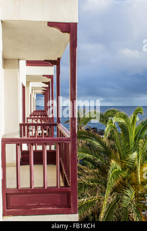 Two Star Apartmentos Central Cancajos hotel offer apartments with a terrace and sea view. - Stock Image