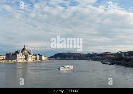 Budapest Parliament viewed from Margit Bridge showing both Buda and Pest each side the river. - Stock Image