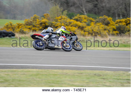 East Fortune, UK. 14 April, 2019.  76 Richard Stanbury closes in on 55 Andrew Cuthbert in a Pre-injection 600, Pre-injection 1200 and Sound of Thunder Championship race at East Fortune Raceway, during the opening rounds of the 2019 Scottish Championships, Melville Open and Club Championships. Credit: Roger Gaisford/Alamy Live News - Stock Image