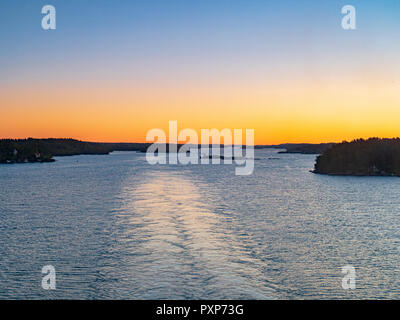 The wake of a cruise liner sailing into port through the Stockholm Archipelago. - Stock Image
