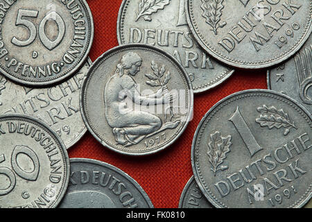 Coins of Germany. Woman planting an oak seedling depicted in the German 50 pfennig coin. - Stock Image