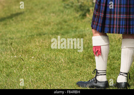 Man dressed in traditional Tartan Kilt an example of Scotlands national costume - Stock Image