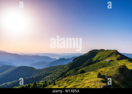 Beautiful panoramic mountain landscape at sunset - Stock Image