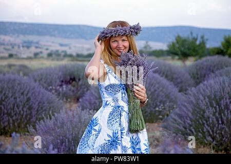 Lady in lavender field. Isparta. Turkey - Stock Image