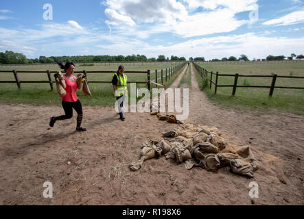 Piled sand bags that competitors were expected to carry around a field - Stock Image