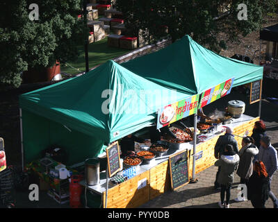 Indian food for sale at a food market by Tower Bridge, London, UK - Stock Image
