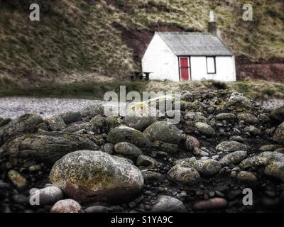 Small hut on beach, East coast of Scotland, UK - Stock Image