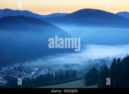 Meadow and hills at sunrise, Mlynky, Slovakia - Stock Image