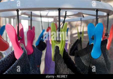 Close up of plastic pegs on clothes dryer England UK United Kingdom GB Great Britain - Stock Image