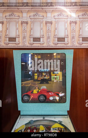 Detail of a custom-made pinball machine and retro wallpaper at Bar Luce, Wes Anderson-inspired bar and cafe in the Fondazione Prada district of Milan, - Stock Image