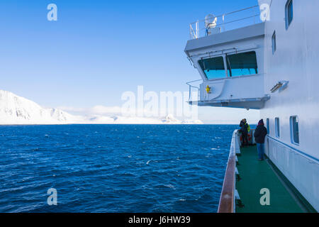 Spectacular mountain scenery seen from a Hurtigruten Coastal Express cruise ship, near Honningsvåg, Norway. - Stock Image