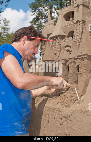 Artist sculpts a sandcastle at 'Art on the Green' in Coeur d'Alene, Idaho, USA. - Stock Image