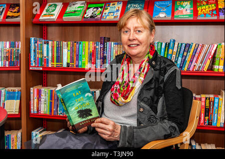 Bantry, West Cork, Ireland. 10th Apr, 2019. Novelist Breda Joy was in Bantry Library today, reading from her debut novel 'Eat The Moon'. Although Breda is still promoting the book, she has started work on her second book. Credit: Andy Gibson/Alamy Live News. - Stock Image