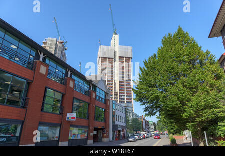 View from Goldsworth Road of the uncompleted core of the new mixed use Victoria Square high rise development under construction in Woking town centre - Stock Image