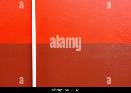 White Plastic Pipe on Two Tone Painted Concrete Wall. - Stock Image
