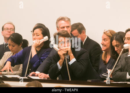 London, UK. 19th June 2019. Sotheby's staff and auctioneers take bids over the phone  at the Impressionist & Modern Art Evening Auction  at Sotheby's London which saw £99 Million $124million sales including Claude Monet's Nymphéas (1908)  which went under the hammer  for £23.7m- $29.8m and Modigliani's Portrait of an Anonymous Youth (1918) which sold  for £18.4m- $23.1m Credit: amer ghazzal/Alamy Live News - Stock Image