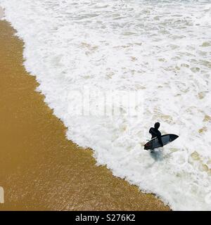 Suffer on the beach from above. Manhattan Beach, California USA. - Stock Image
