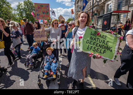 London, UK. 12th May 2019. Several thousand mothers and children and some fathers on the XR International Mothers Day March from Hyde Park Corner to a rally filling Parliament Square, backing Extinction Rebellion's call for the drastic and urgent action needed to avert the worst consequences of climate change, including possible human extinction. Our politicians have declared a climate emergency but now need to take real action rather than continuing business as usual which is destroying life on our planet. Peter Marshall/Alamy Live News - Stock Image