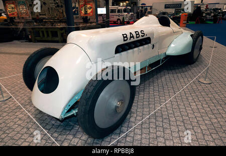 Three-quarter front view of BABS, a land speed record car at the 2019 London Classic Car Show, in  'The need For Speed', display curated by Edd China. - Stock Image