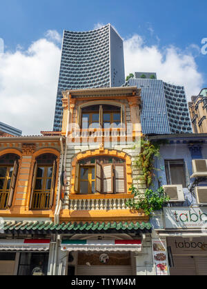 DUO office towers over Arab Street traditional shophouses fabric shops Kampong Glam Singapore. - Stock Image