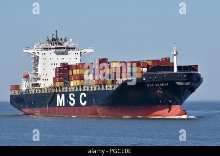MSC Geneva passing Cuxhaven heading for Hamburg - Stock Image