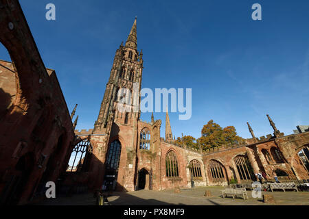 St Michaels Tower and the ruins of Coventry Cathedral on Priory Street in Coventry city centre UK - Stock Image