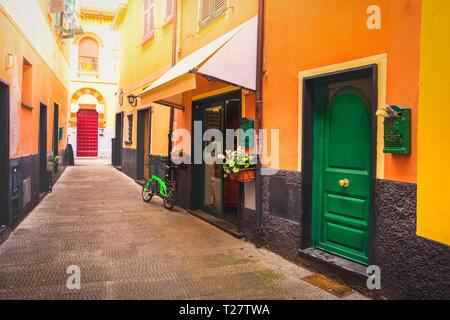 colourful italian alley green door . - Stock Image