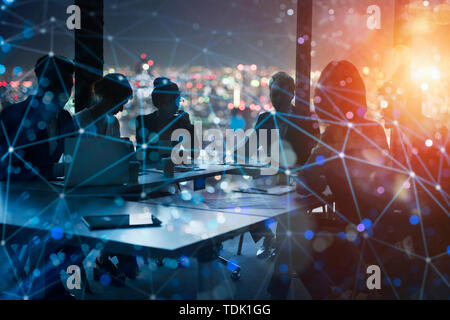 Businessmen that work together in office at night. concept of teamwork and partnership. - Stock Image