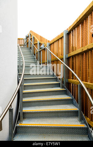 Metal staircase fire escape up side of modern building. - Stock Image