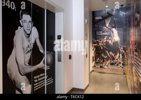 The area by the elevator with murals of earlier era NBA stars inside the NBA store on Fifth Ave. in MIdtown, Manhattan, New York City. - Stock Image