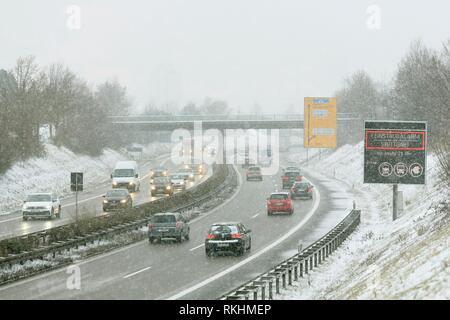 Motorway, road traffic in winter with heavy snowfall, Stuttgart, Baden-Württemberg, Germany - Stock Image