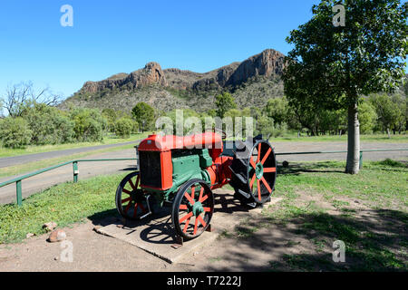 An old red and green Fordson tractor in front of scenic Minerva Hill National Park, Queensland, QLD, Australia - Stock Image