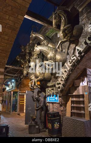Horse sculpture Camden market London at night - Stock Image