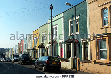 Colourful terraced housing in Gwilliam Street in Windmill Hill, Bristol, UK. - Stock Image