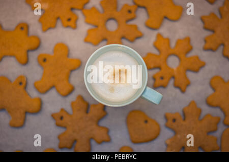 Cappuccino cup and home-made gingerbread in the background - Stock Image