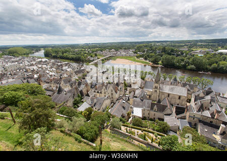 Chinon, France. Picturesque aerial view of Chinon with the tower of Eglise Saint Maurice on the right of the image. The River Vienne and the village o - Stock Image