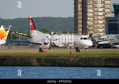 Saab 2000 passenger aeroplane taxiing at London City Airport London UK - Stock Image