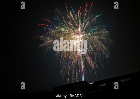 Fireworks exploding in the night sky - Stock Image
