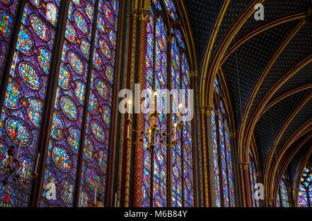 Beautiful interior of the Sainte-Chapelle royal chapel on the Ile de la Cite in Paris France with a hanging chandelier - Stock Image